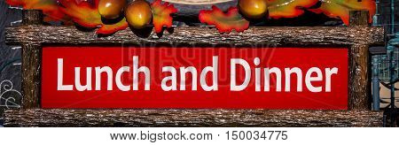 Red and white lunch and dinner sign