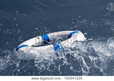 Lifebuoy lifebelt life saver in a dangerous storm wave as help