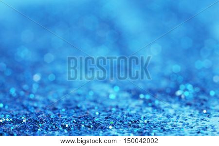 Defocused blue glitter   background