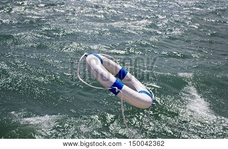 Lifebuoy lifebelt lifesaver in dramatic ocean storm as a help equipment