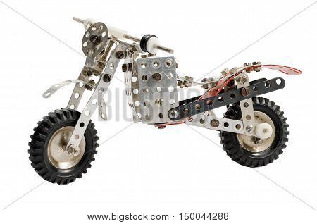 Toy old vintage motorbike isolated on white background