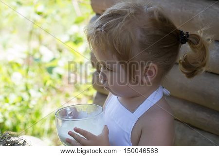 Cute Little Boy Drinks Milk