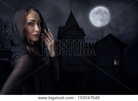 Woman In Black In Front Of Old House On A Moonlit Night