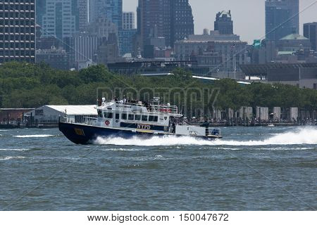 NEW YORK NY - May 25 2016: A New York Police Department boat patrols the Hudson River during the Parade of Ships kicking off Fleet Week.