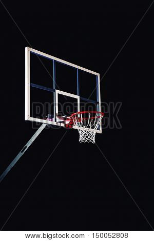 Basketball houp on black arena background, sport concept