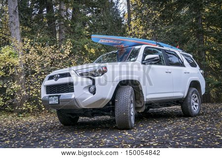 CRYSTAL, CO, USA - SEPTEMBER 28, 2016: Toyota 4Runner SUV (2016 Trail edition) carrying  a paddleboard on a back country road in Colorado's Rocky Mountains