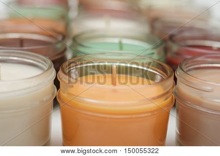 rows and rows of different colored candles