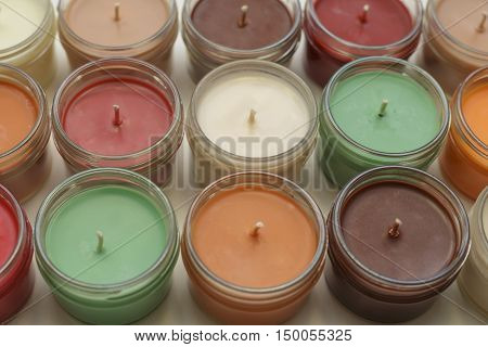 lots of very colorful container candles together