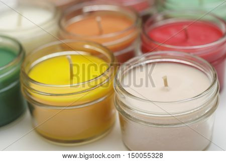 a close up look at a bunch of colorful candles