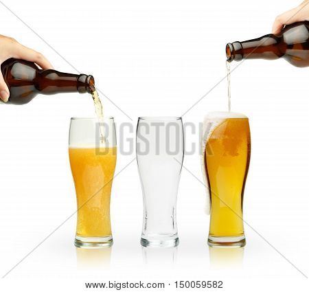 Light golden beer pouring down from brown bottles into glasses with bubbles and foam. Three empty and full glasses with reflections standing isolated on white background.