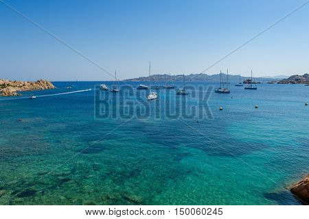 Beautiful mediterranean bay with turquoise water and sailing boat anchorage. Porto Massimo, Sardinia, Italy.