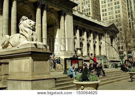 New York City - March 30 2005: Entrance facade to the New York Public Libary and sculpture of Patience the Lion