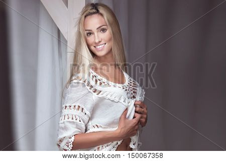 Sensual Blonde Woman With Toothy Smile.