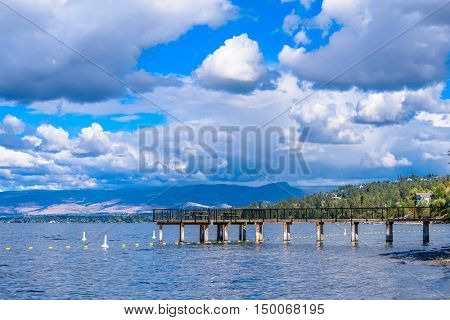 An empty pier on mountain lake in summer. Canada. Okanagan Lake. British Columbia.