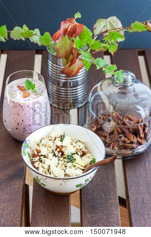 Rustic breakfast set with smoothie, bulgur and nuts