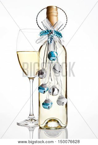 Bottle and glass white wine christmas decoration on white background