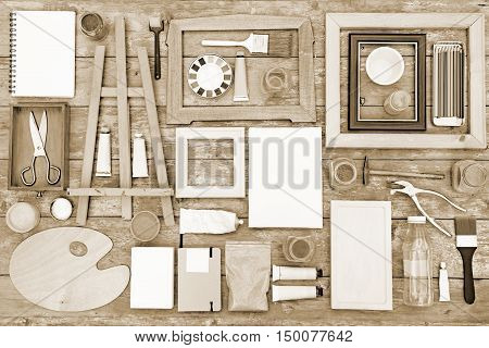 Painting equipment on a wooden background - toned image