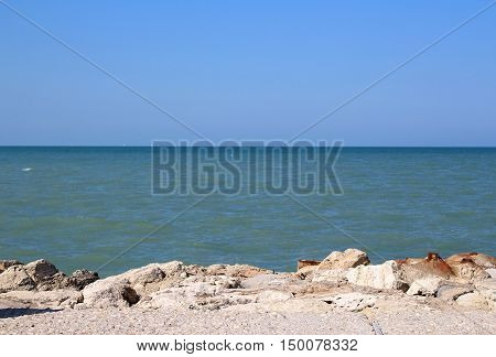 Sea with stones. Rocks in mare. Sea horison.