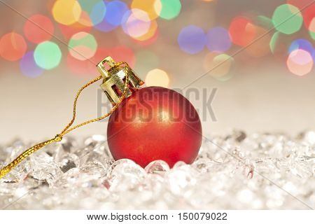 Red Christmas ball on sparkle glass beads