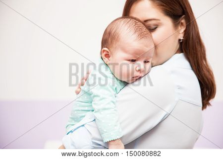 Mother Carrying Her Newborn Baby