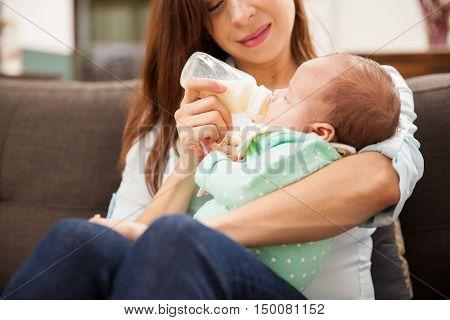 Newborn Baby Drinking Milk From A Bottle