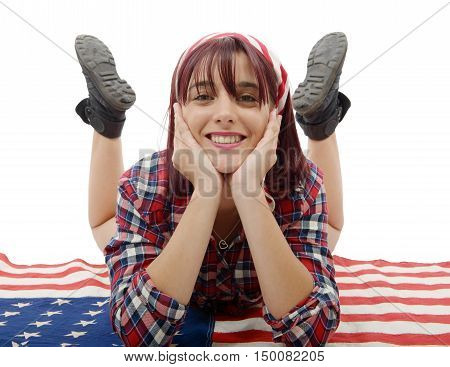 a beautiful young woman lying on an American flag