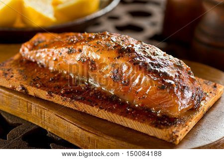 A single serving portion of delicious cedar smoked salmon.