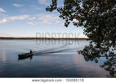 The boat floats on the lake. Natural landscapes