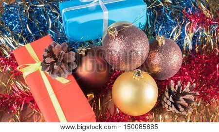 Gifts and Christmas balls of Christmas tinsel. Christmas background