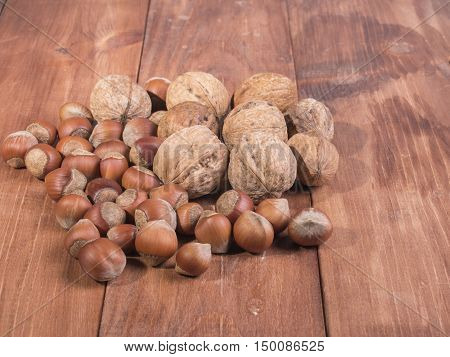 Mix of nuts on wooden background. Healthy lifestyle