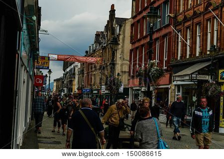 FORT WILLIAM, SCOTLAND--AUGUST 18, 2016--Tourist and locals walking along the main street area of Fort William, Scotland.