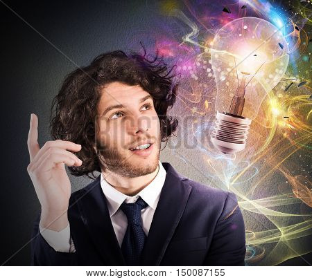 Businessman watching a light bulb drawn and thinks a new creative idea