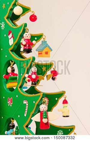 Cute Moe green wooden Christmas tree of red ribbon.