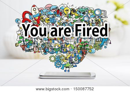 You Are Fired Concept With Smartphone