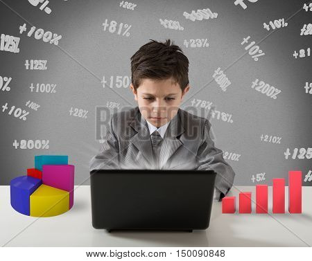 Young manager works with computer graph and stats