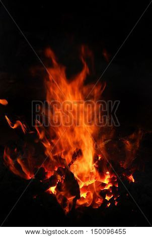 image of stone charcoal fire on bugle as abstract background