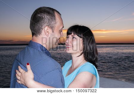 A man and  woman on sunset background