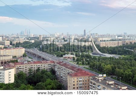 MOSCOW - MAY 29. 2016: Conquerors of Space Monument and city road at summer evening