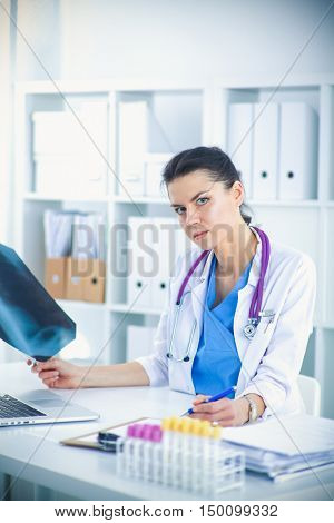Medical team sitting at the table in modern hospital