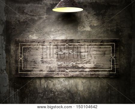 Old wooden banner hanging on a dark grungy wall