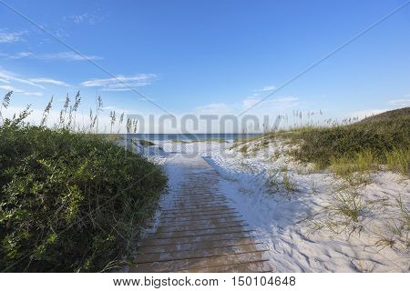 Boardwalk footpath through pristine sand dunes to the Gulf of Mexico in Pensacola Florida horizontal format