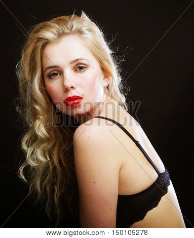 blond woman with  curly hair in black lingerie