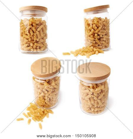 Set of glass jar filled with dry rotini yellow pasta over isolated white background, different foreshortenings