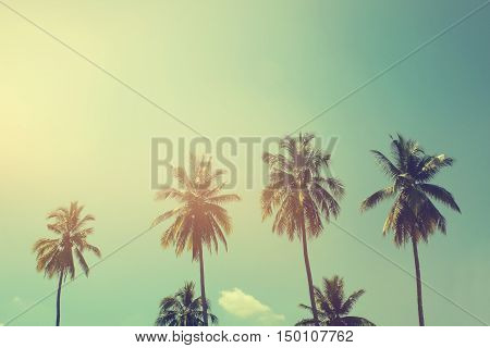 Palm trees at tropical coast vintage toned and film stylized