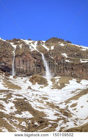 Slope of mountain Elbrus. Tails of little avalanche from the comb of mountain