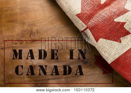 The poster with the national flag of Canada - Made in Canada.