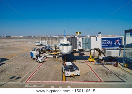 NEW YORK - MARCH 22, 2016: passenger jet airplane docked at JFK Airport. John F. Kennedy International Airport is a major international airport located in the borough of Queens in New York City.
