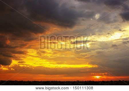 Beautiful Sunset Sky With Multicolor Clouds After Strom. Amazing Sunset. Warm Light Sunset.