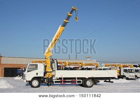 Great White Auto Truck Crane Standing On Construction Site In Winter - Russia, Crimea -january, 21,