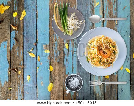 Top view of Pad Thai on the side of the table.